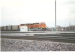 BNSF 5882 ES44AC with BNSF 5775 rolling west with mty coal cars